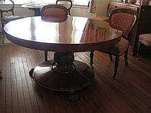 A VICTORIAN MAHOGANY CIRCULAR DINING TABLE with tilt-top, octagonal baluster column and circular plateau with carved claw feet. Diam...