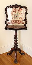 A VICTORIAN ROSEWOOD SIDE TABLE with bead and needlework panel back; on carved tripod base. Height 140cm.