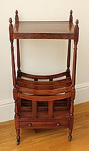 A VICTORIAN MAHOGANY WHATNOT/CANTERBURY with slender turned columns, acorn finials and with a drawer to the base. Height 115cm. Widt...