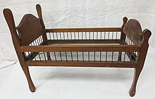 Handmade doll bed with side rods and screen bottom, folk art