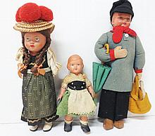 Three antique Celluloid dolls incl. early wind-up walker, original clothes