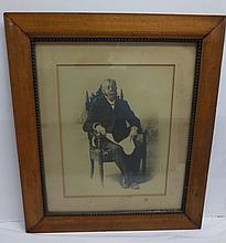 Oak framed antique photograph - seated gentleman - 27x23