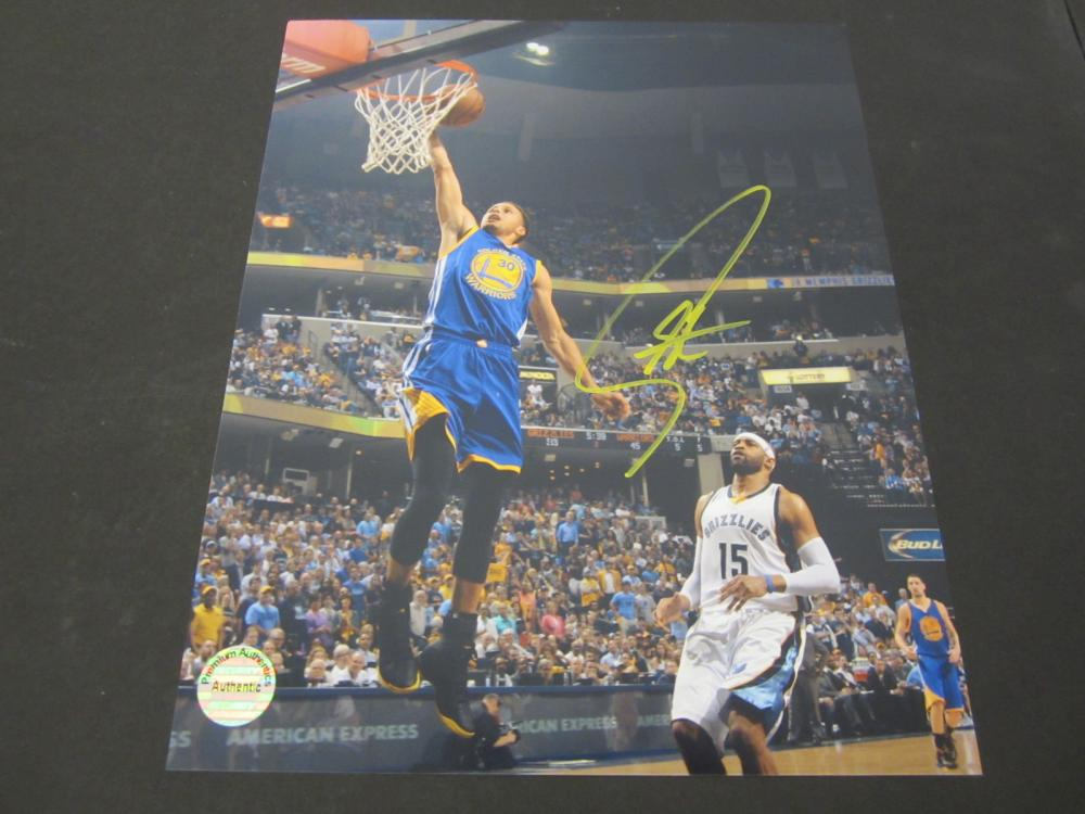 Lot 141: STEPHEN CURRY SIGNED AUTOGRAPHED WARRIORS 8X10 COA