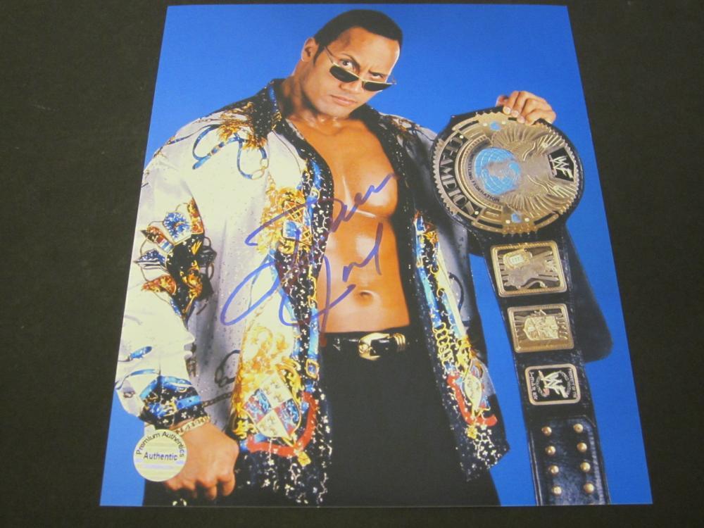 Lot 148: DWAYNE JOHNSON SIGNED AUTOGRAPHED WWE 8X10 COA