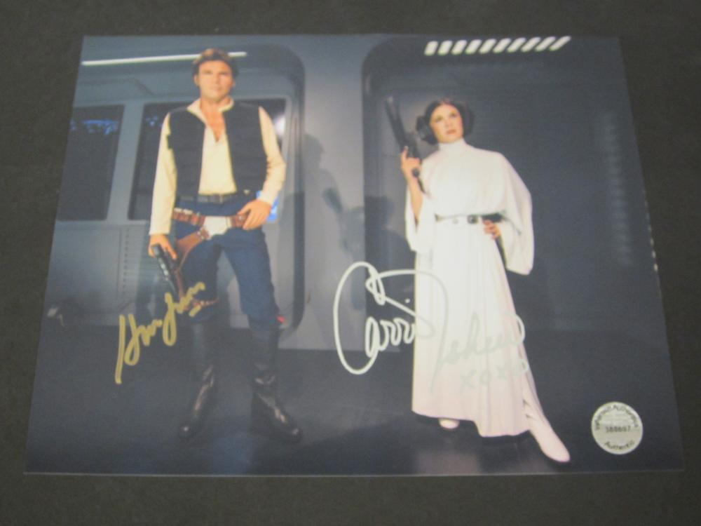 Lot 214: HARRISON FORD,CARRIE FISHER SIGNED AUTOGRAPHED STAR WARS 8X10 COA