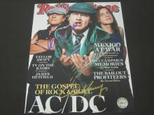 Lot 217: ANGUS YOUNG SIGNED AUTOGRAPHED MAGAZINE COA