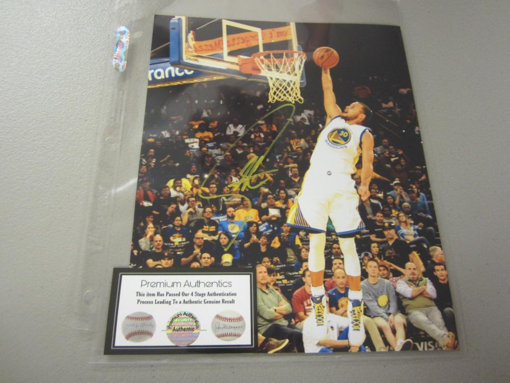 Lot 562: STEPHEN CURRY SIGNED AUTOGRAPHED WARRIORS 8X10 COA