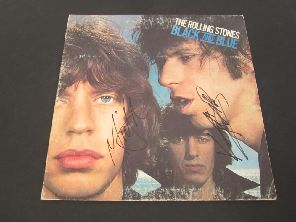 Lot 656: Rolling Stones Band signed autographed Record Album Mick Jagger and others Certified Coa