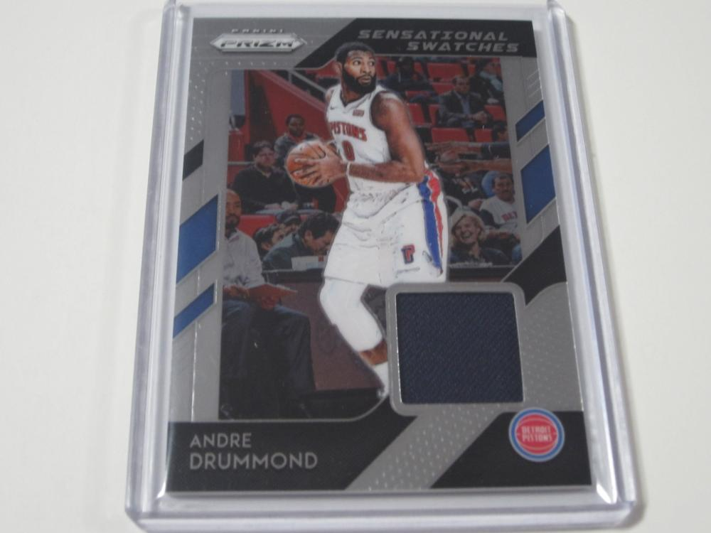 Lot 716: 2018/19 PANINI PRIZM BASKETBALL SENSATIONAL SWATCHES JERSEY RELIC HOLO ANDRE DRUMMOND DETROIT PISTONS SPORTS CARD #42