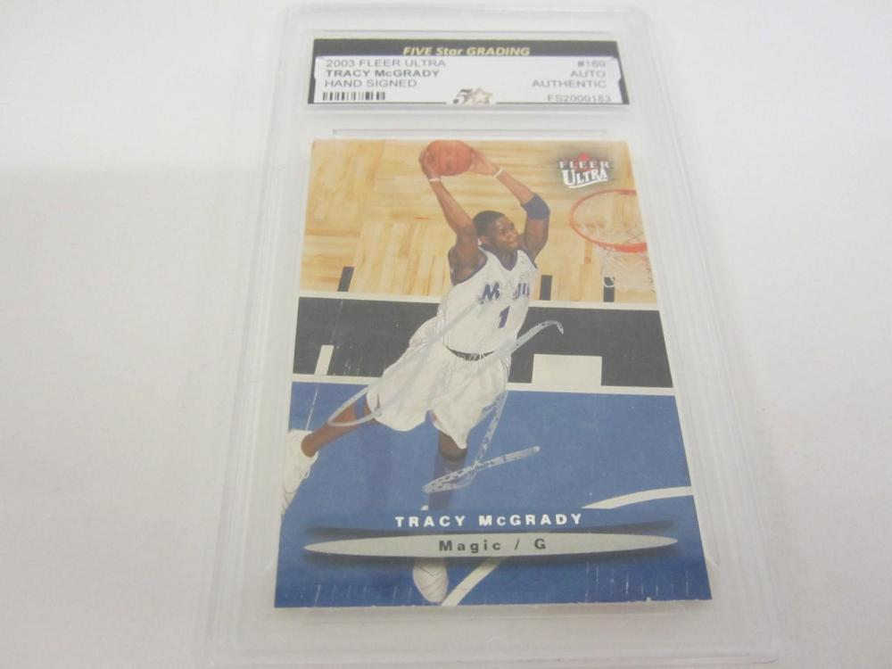 Lot 953: 2003 FLEER ULTRA TRACY MCGRADY HAND SIGNED AUTOGRAPHED CARD SLABBED