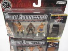 Lot 124: WWE MICRO AGGRESSION 9 FIGURES SEALED