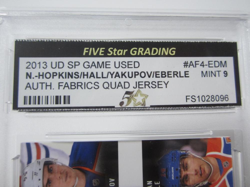 Lot 25: 2013 UD SP GAME USED HOPKINS/HALL/YAKUPOV/EBERLE QUAD PIECE OF GAME USED JERSEY CARD GRADED MINT 9