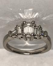 Exceptional Platinum 1.0 TCW VVS1, F color  emerald cut diamonds wedding ring.