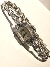 Antique platinum and 14K gold 1.25 TCW VS1, F color diamonds elgin wristwatch.