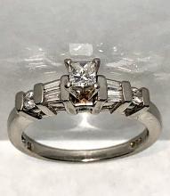Platinum 0.55 TCW princess VS2, G color diamonds on fire wedding ring.