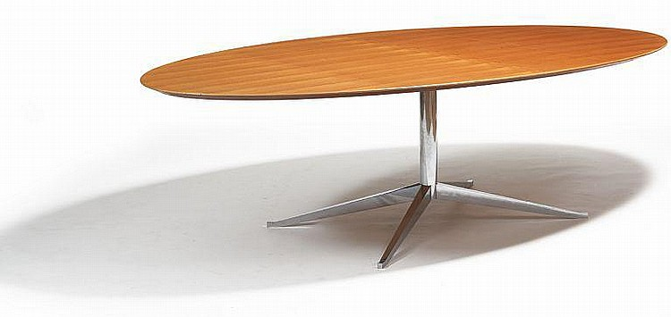 Florence Knoll: Dining table with oval teak top. Base of chromed steel. L. 240 cm.