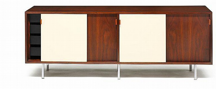 Florence Knoll: Sideboard. Front with four sliding doors, partly with later paint, leather handles. Chromed steel legs.