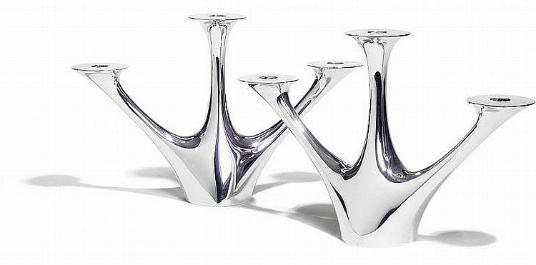 Henning Koppel: A pair of rare sterling silver three-branch candelabras. Smooth corpus. (2)