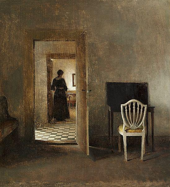 Peter Ilsted: Interior from Liselund with a woman standing in the doorway. In the foreground a table and a chair.