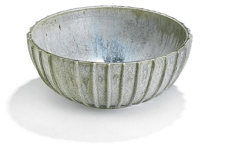 Arne Bang: Stoneware bowl modelled with rifled pattern in relief. Decorated with bluish green glaze. Signed monogram 113. H. 15 cm. Diam. 37 cm.
