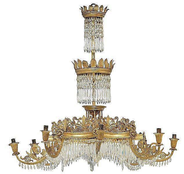 A German giltwood, gilt lead and cut glass eight-light chandelier. Berlin, c. 1830. H. 92 cm. Diam. 91 cm.