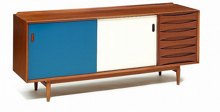 Arne Vodder: A sideboard with sliding doors and drawers.