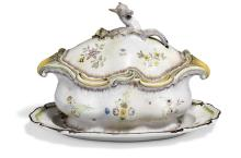 Marieberg faience hunting-tureen with dish, decorated in colours with scattered flowers. Sweden, 18th century. Tureen L. 38 cm. Dish L. 41 cm.