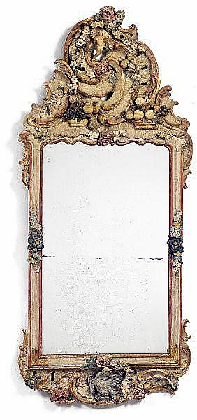 A South German polycrome decorated Rococo mirror ascribed to Franz Ignaz Günther (1725-1775). Munich, mid 19th century. H. 160 cm. W. 71 cm.