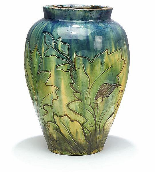 Thorvald Bindesbøll: Large unique earthenware vase. Enchased with scratched motif of leaves. H. 49 cm.
