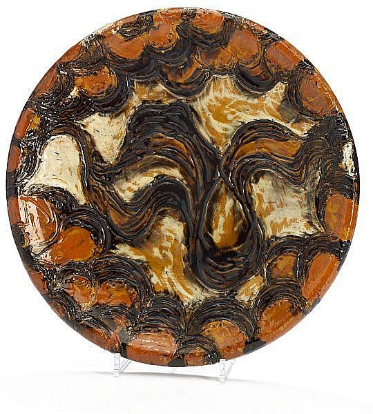 Thorvald Bindesbøll: Unique art nouveau earthenware dish with scratched ornamentation in relief. Decorated with brown, ochre and black glaze.
