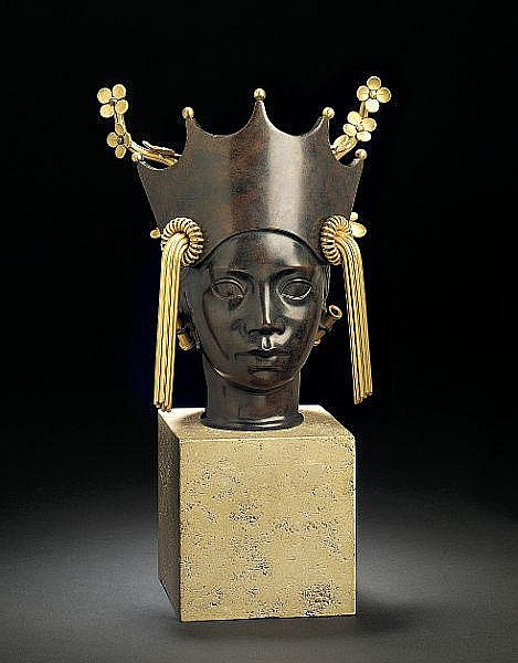 Arno Malinowski: Bust of patinated and partly gilded bronze in the shape of a womans head. H. incl. base 30,3 cm.