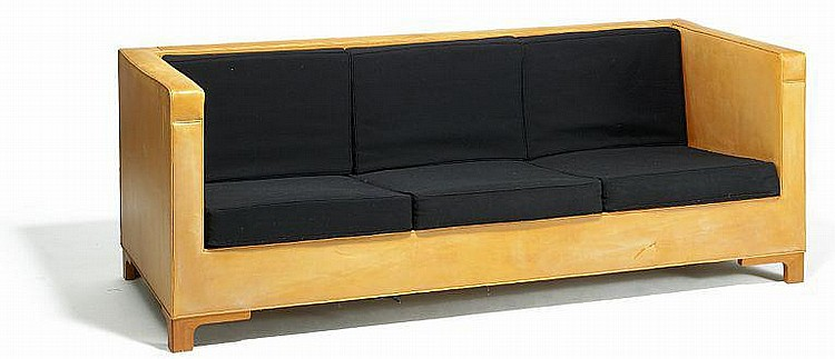Alvar Aalto: A rare, freestanding box-shaped sofa upholstered with patinated natural-colored leather and black wool. L. 208 cm.