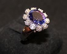 A Tanzanite and Diamond Set Ring