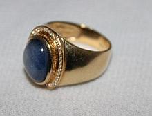 A Gents Star Sapphire and Gold Dress Ring