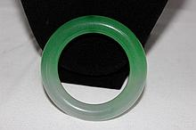 A Chinese Green Hardstone Bangle