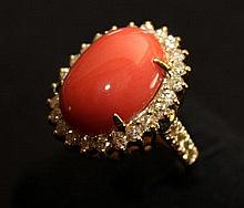 A Coral and Diamond Set Gold Ring