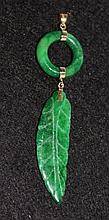 An Unusual Chinese Yellow Gold Mounted Jade Leaf Pendent
