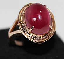 An  Rose Gold Cabachon Ruby Dress Ring