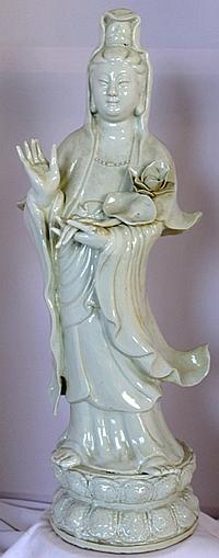 A Chinese Celadon Carved Guan Yin Figure