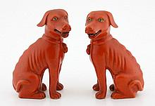 A PAIR OF CHINESE SEATED DOGS
