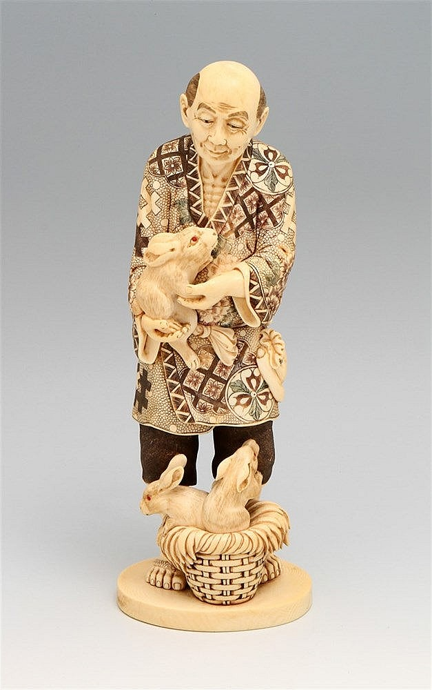 FIGURE OF A JAPANESE WITH RABBITS