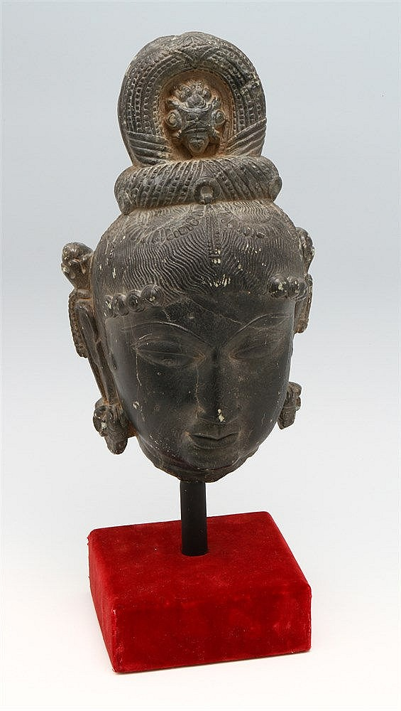 HEAD OF AN ORIENTAL DEITY