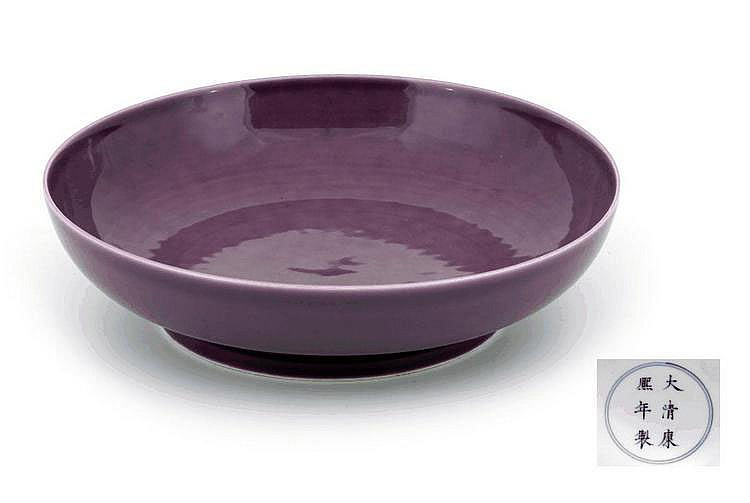 A CHINESE PURPLE GLAZED SAUCER