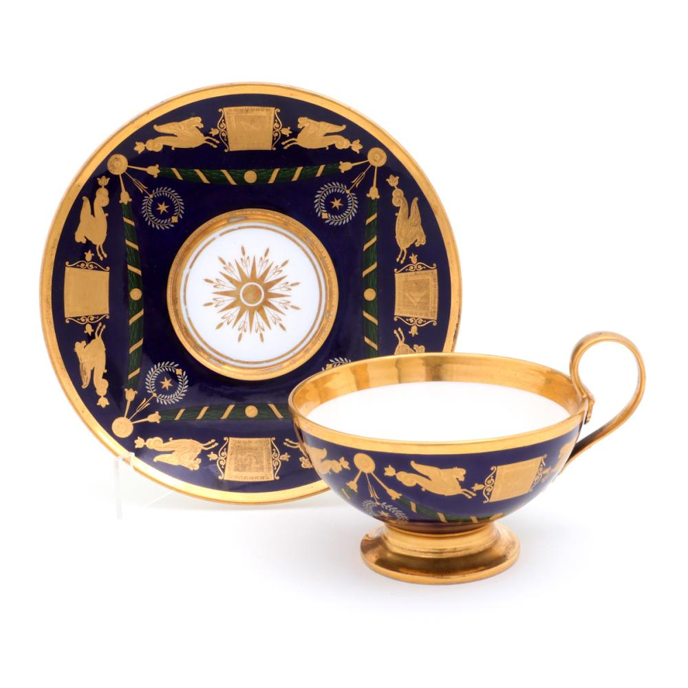 AN EMPIRE CUP AND SAUCER WITH MASONIC SYMBOLS