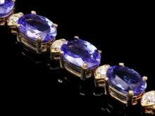 Lot 104: 14K Gold 17.13ct Tanzanite 0.81ct Diamond Bracelet