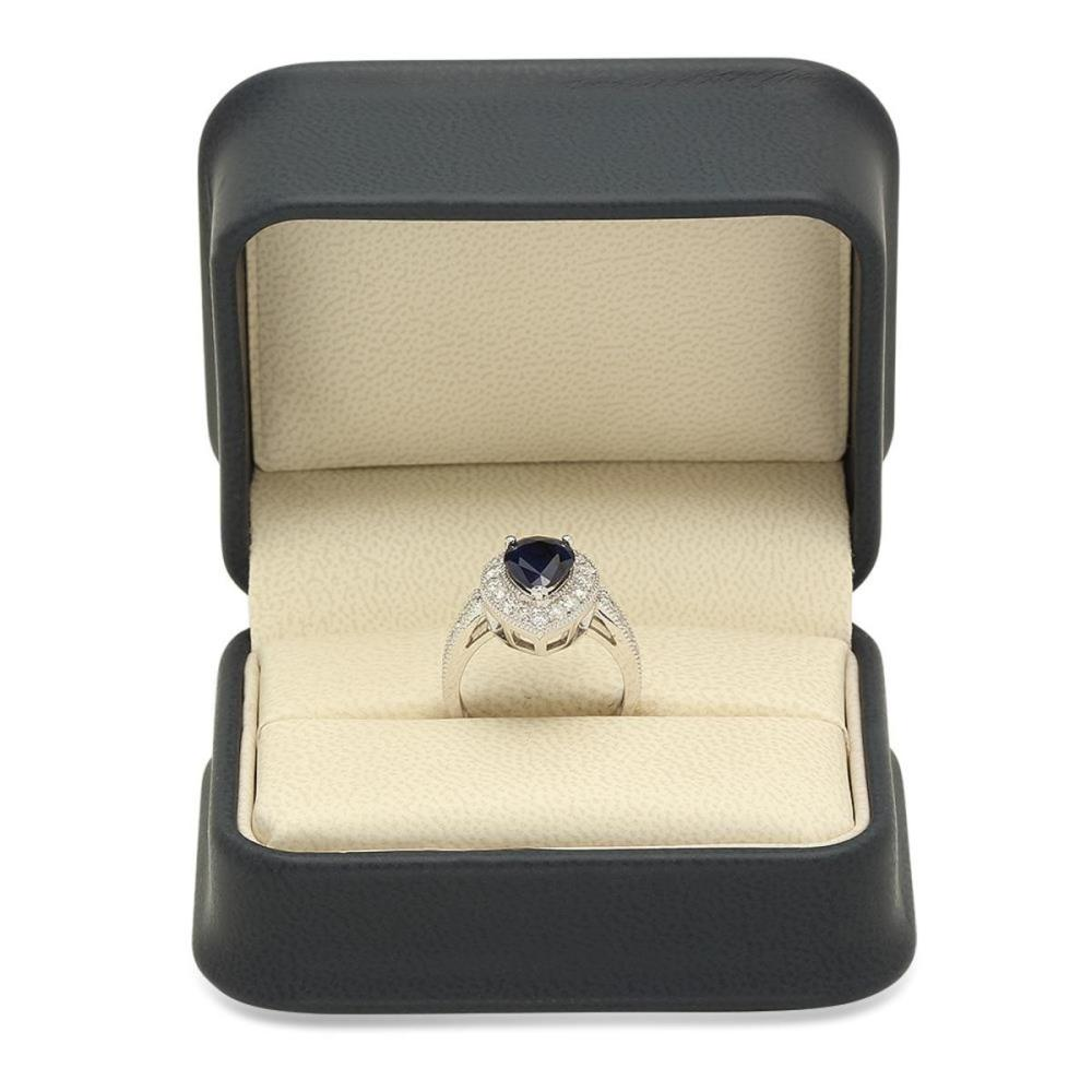 Lot 111: 14K White Gold 2.31ct Sapphire and 1.07ct Diamond Ring