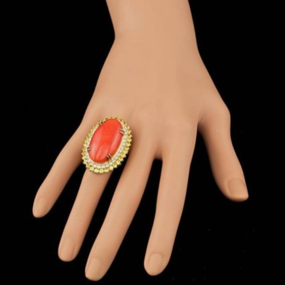 Lot 130: 14K Yellow Gold 18.83ct Coral 2.48ct Sapphire and 1.52ct Diamond Ring