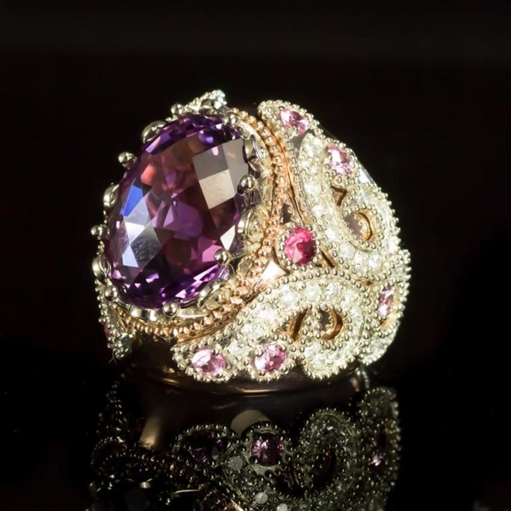Lot 134: 14K Rose and White Gold 16.01ct Amethyst 1.08ct Sapphire and 1.29ct Diamond Ring