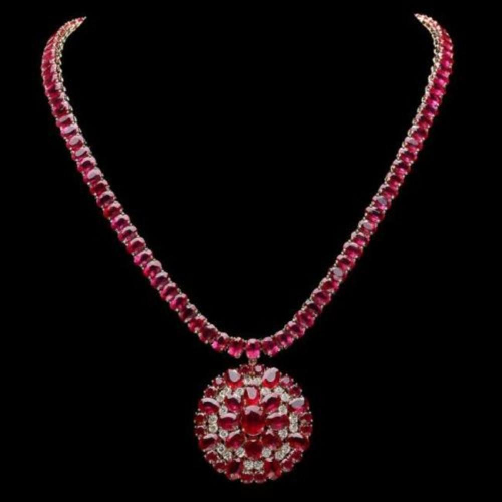 Lot 180: 14K Yellow Gold 94.35ct Ruby and 1.20ct Diamond Necklace