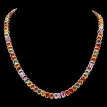 Lot 188: 14K Yellow Gold 57.98ct Fancy Color Sapphire Necklace